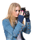 Girl taking picture with vintage film camera in casual clothes Royalty Free Stock Photo