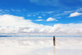 Girl taking pictures on camera of salar de uyuni bolivia Stock Photography