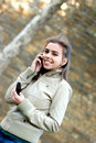 Girl talking on a cell phone Stock Images