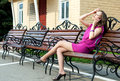 Girl talking on cell phone attractive young adult female outdoors bench Stock Photo
