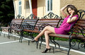 Girl talking on cell phone attractive young adult female outdoors bench Royalty Free Stock Images