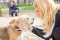 Girl talking to a dog with love her loving face face Royalty Free Stock Photos