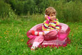 Girl talks by toy phone in inflatable armchair Royalty Free Stock Photo