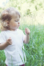 Girl in the tall grass portrait of a little blonde Royalty Free Stock Photos
