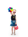 Girl in tanktop and skirt with a toy Royalty Free Stock Photo