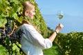 Girl tasting white wine among vineyards Royalty Free Stock Photo