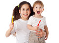 Girl teaches boy brushing the teeth little isolated on white Stock Photos