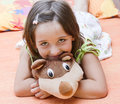 Girl with teddy bear little her Stock Photos