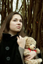 Girl with teddy bear in the park Royalty Free Stock Photos