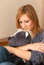 Girl and teddy young adult hugging a toy Royalty Free Stock Images