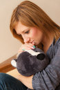 Girl and teddy young adult hugging a toy Royalty Free Stock Photography