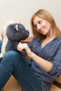 Girl and teddy young adult hugging a toy Stock Photography