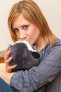 Girl and teddy young adult hugging a toy Stock Photo