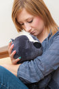 Girl and teddy young adult hugging a toy Royalty Free Stock Photos