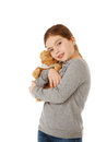 Girl with teddybear hugging and playing isolated Stock Photography
