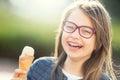 Girl. Teen. Pre teen. Girl with ice cream. Girl with glasses. Girl with teeth braces.