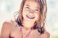 Girl with teeth braces. Pretty young teen girl with dental braces. Portrait of a cute little girl on a sunny day in bikini