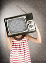 Girl with television on her head Stock Photo