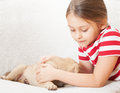 Girl tenderly embraces a pet cute little Royalty Free Stock Photography