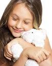 Girl tenderly embraces plush toy Royalty Free Stock Photo