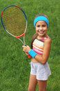 Girl with tennis racket Royalty Free Stock Images