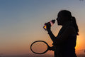 Girl tennis water silhouette teenage shadows with bottle and racket Royalty Free Stock Images