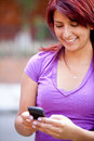 Girl texting on the phone Royalty Free Stock Photography