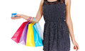 Girl with three bag s a young woman holding her shopping four and a credit card a closeup picture of her body isolated over white Royalty Free Stock Image