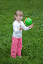 Girl throwing a ball Royalty Free Stock Images