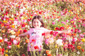 Girl throwing flower petals Royalty Free Stock Photo