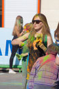 Girl throws paint the festival of colors holi in cheboksary chuvash republic russia holiday joy Stock Images