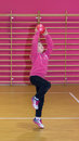 Girl throws a red ball in the basket at sports hall Royalty Free Stock Images