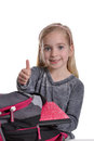 Girl thumbs up backpack white background Royalty Free Stock Photos