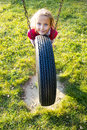 Girl on Tire Swing Royalty Free Stock Photo