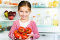 Girl with tomatos Royalty Free Stock Image