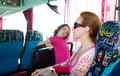 Girl on tourist bus happy with sunglasses Stock Photography