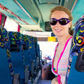 Girl on tourist bus happy with sunglasses Stock Image