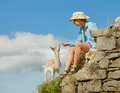 Girl tourist with little goatling Stock Images