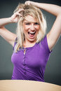 Girl tousling her hair blond and having fun Stock Images