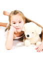 The girl with a toy puppy on white background Royalty Free Stock Images