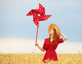 Girl with toy wind turbine redhead at wheat field Stock Photography