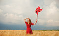 Girl with toy wind turbine redhead at wheat field Stock Photo