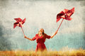 Girl with toy wind turbine redhead at wheat field Royalty Free Stock Images