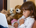 The girl, toys and laptop. Stock Images