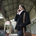 Girl at train station Royalty Free Stock Photo