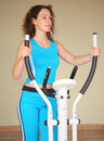 Girl on training apparatus Stock Photos