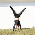 Girl training cartwheel Royalty Free Stock Photo