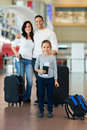 Girl travelling with parents beautiful little her at airport Royalty Free Stock Photo