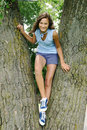 Girl in a tree Royalty Free Stock Photo