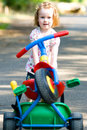 Girl with tricycle Stock Photography